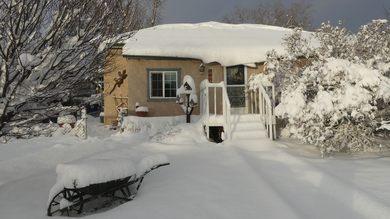 our house covered in snow