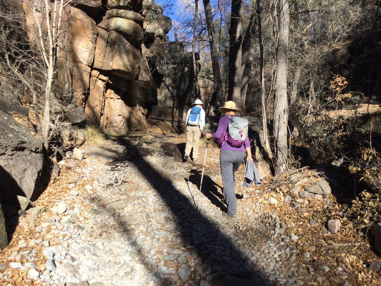 hikers in narrow canyon